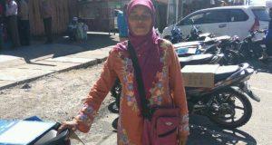 Amni, Juru Parkir Perempuan Tangguh di Bener Meriah